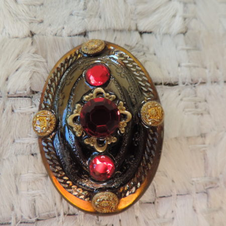Oval Pin With Red Stones Signed Patti Horn
