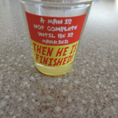 Shot Glass –  A Man Is Not Complete Until He Is Married …….