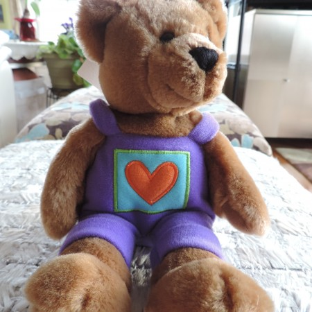 Valentine Teddy Bear Boy 10″ Tall Has On Purple Overalls In The Middle Orange Heart NEW