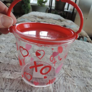 Valentine Clear Little Bucket With X's & O's And Colored Hearts 3 1/2″ High